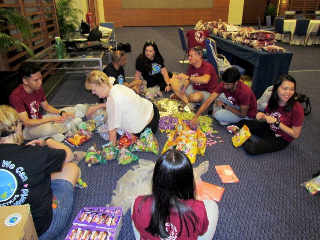The team assembling the goodie bags for every child!